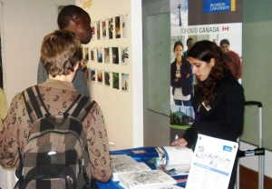 Canadian immigrant youth visiting UforChange's education fair