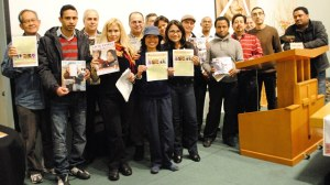A group of internationally trained journalists and writers attending an event about immigrants and jobs in Canada